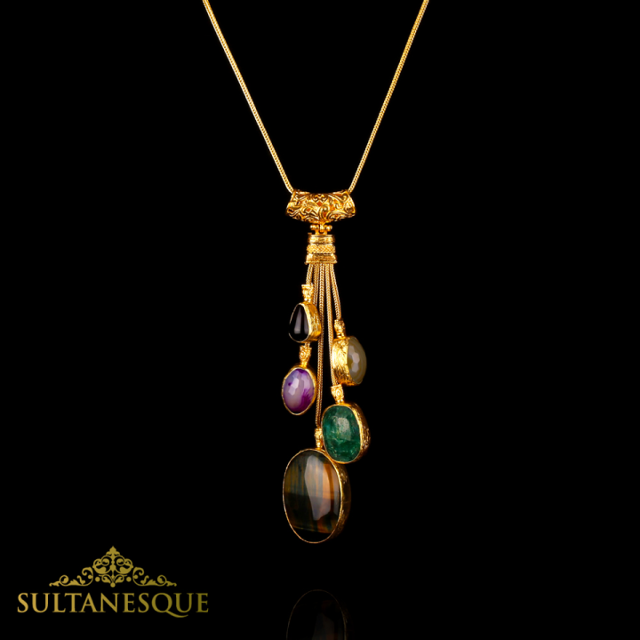 """Black Onyx, Emerald, Boulder Opal, Botswana Agate and Purple Sardonyx Agate stones are beautifully handcrafted into a necklace plated in 22k Gold on Bronze"""