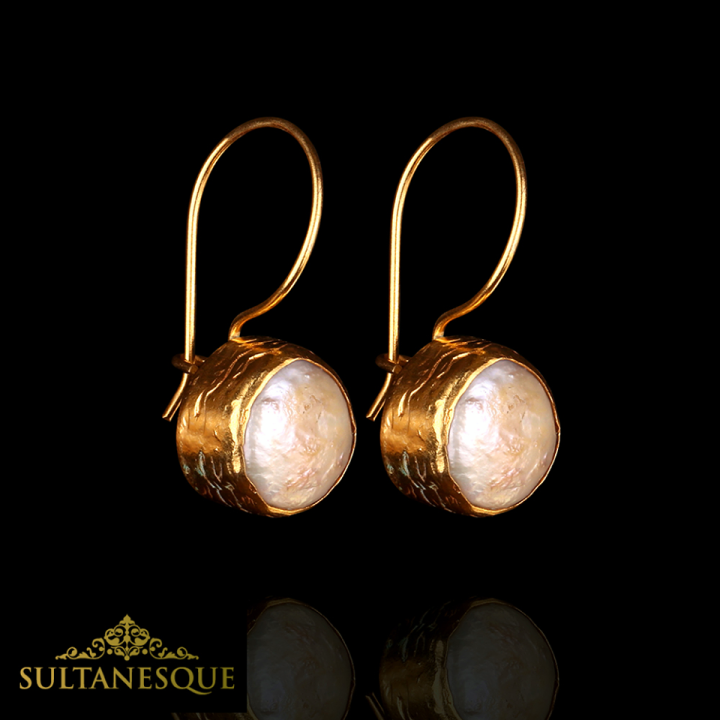 """This beautifully handcrafted pair of earrings are made with Fresh Water Pearls and are plated with 22k Gold on Bronze."""